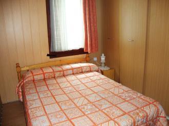 dormitorio_6-apartamentos-vaquers-3000pas-de-la-casa-estacion-grandvalira.jpg