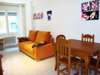 salon-comedor_2-apartamentos-vaquers-3000pas-de-la-casa-estacion-grandvalira.jpg