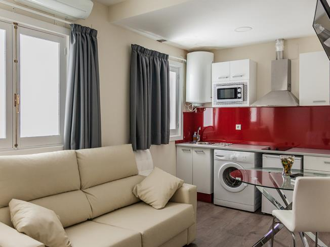 salon-comedor_3-apartamentos-valentina-deluxe-3000granada-andalucia.jpg