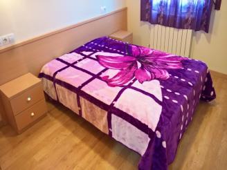 dormitorio-apartamentos-pantebre-3000-pas-de-la-casa-estacion-grandvalira.jpg