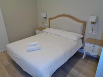 dormitorio-apartamentos-trinidad-deluxe-3000-granada-andalucia.jpg