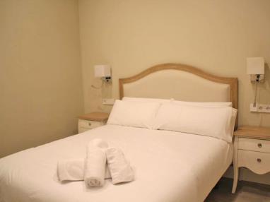 Dormitorio Apartamentos Trinidad Deluxe 3000 Granada