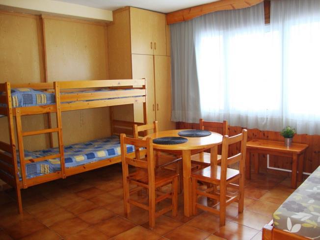 salon-comedor_9-apartamentos-sapporo-3000pas-de-la-casa-estacion-grandvalira.jpg