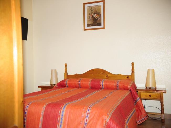 dormitorio_1-apartamentos-lake-placid-3000pas-de-la-casa-estacion-grandvalira.jpg