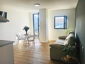 salon-comedor-9-apartamentos-santander-maliano-suites-3000maliano-cantabria.jpg